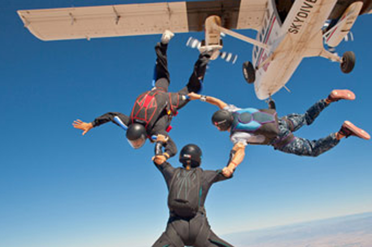 Experienced skydivers practicing 3-way formation.