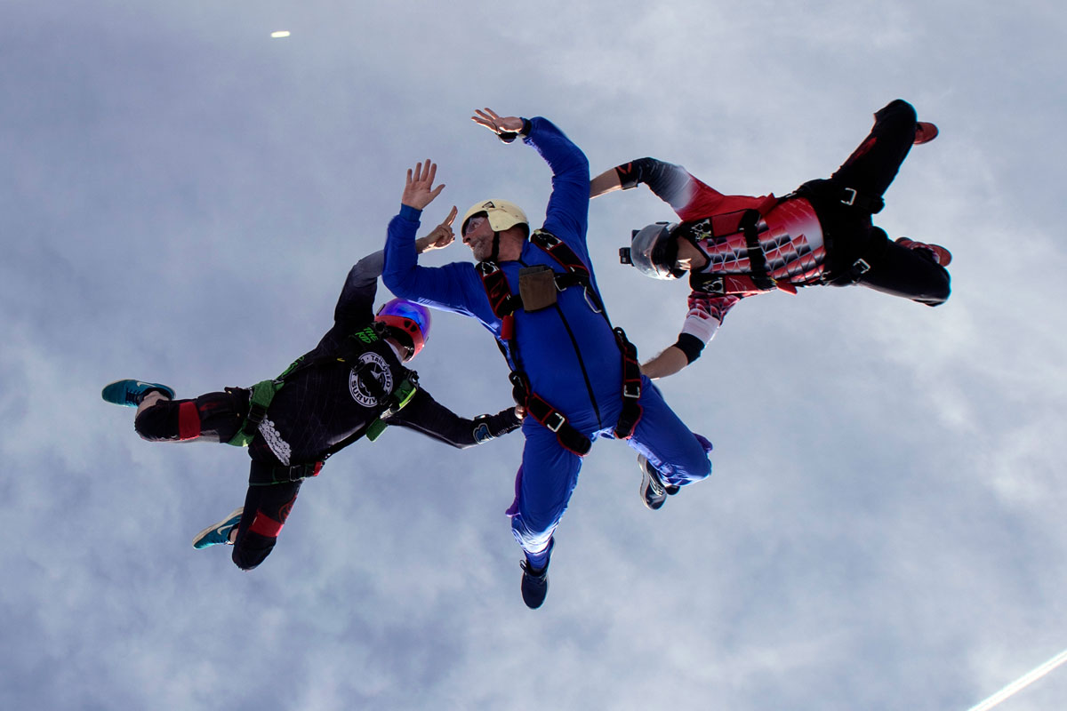 Male in blue skydiving gear participating in AFF training at Skydive City