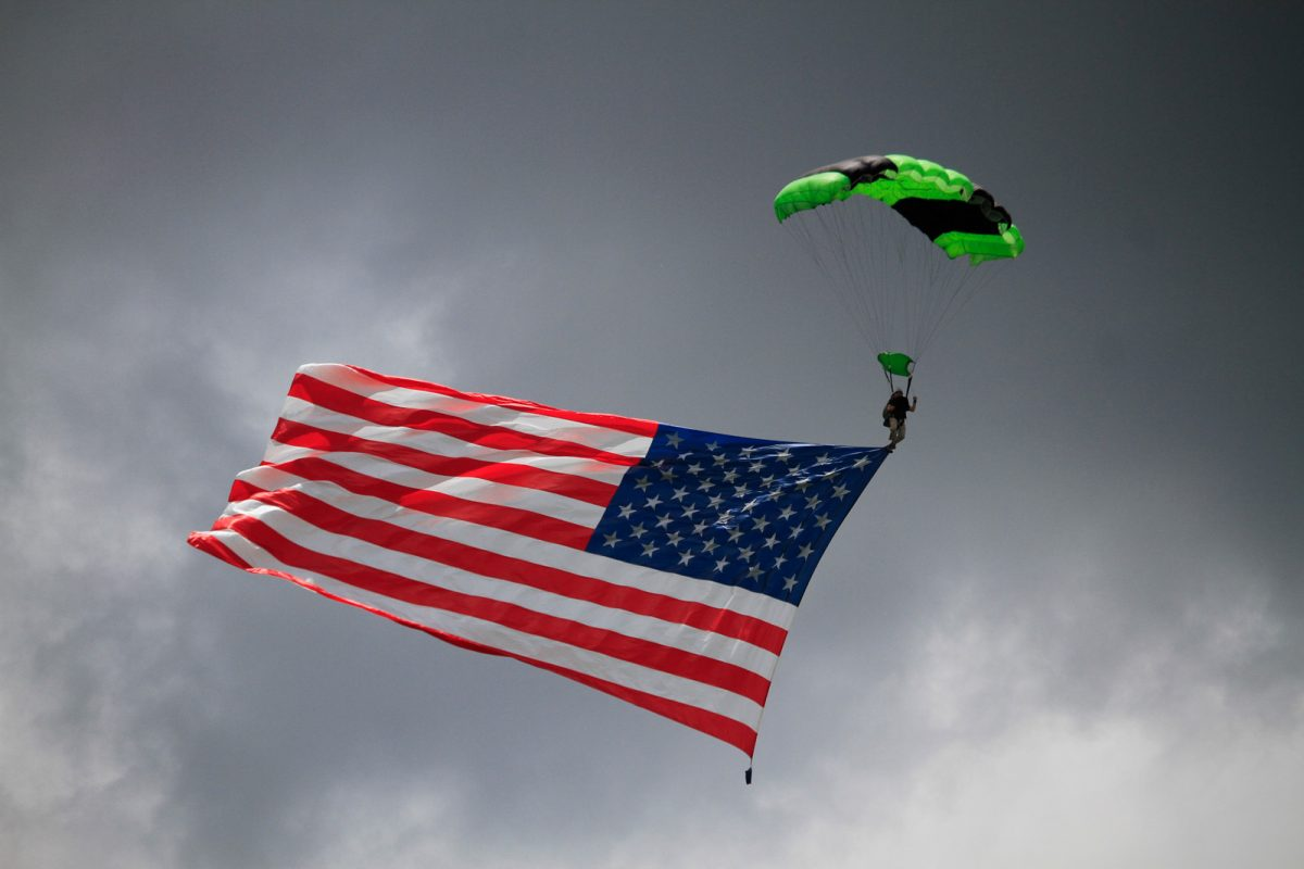 Fun jumper skydiving with American flag.