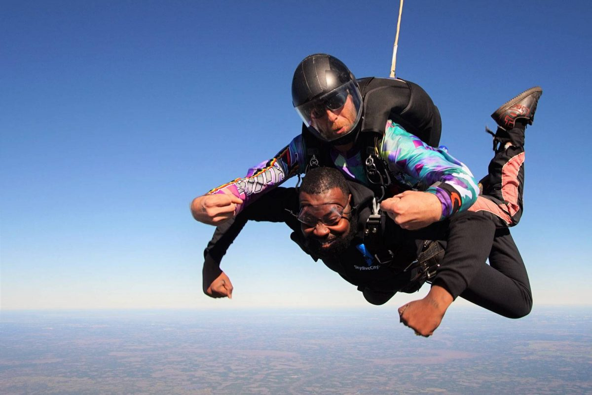 Tandem jumper excited to be in freefall while skydiving at Skydive City.