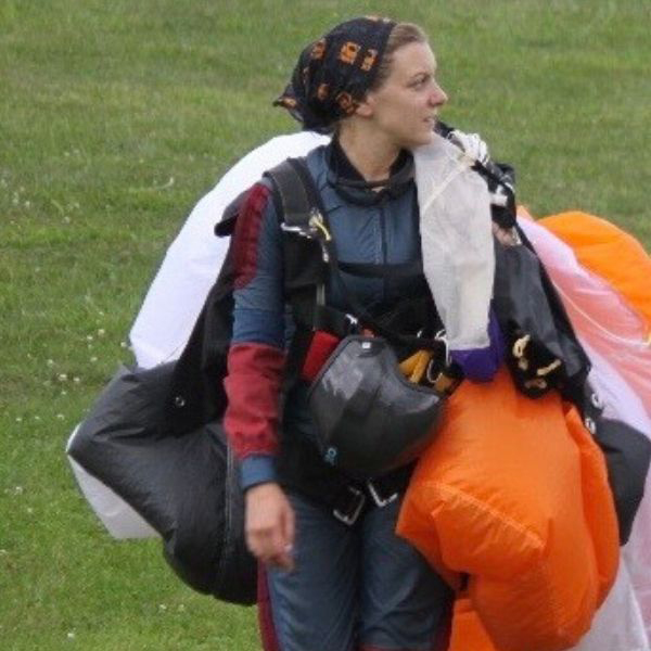 Emily Vanderburg carrying her parachute after a jump at Skydive City