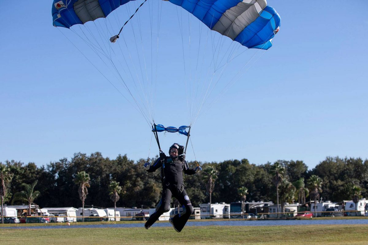 Experienced jumper swooping with RV Park in the distance at Skydive City