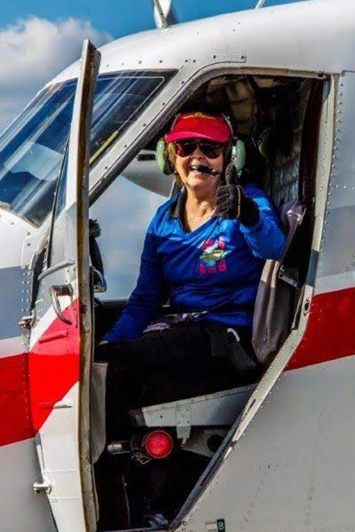 Sandy Carruth giving thumbs up in Skydive City aircraft.