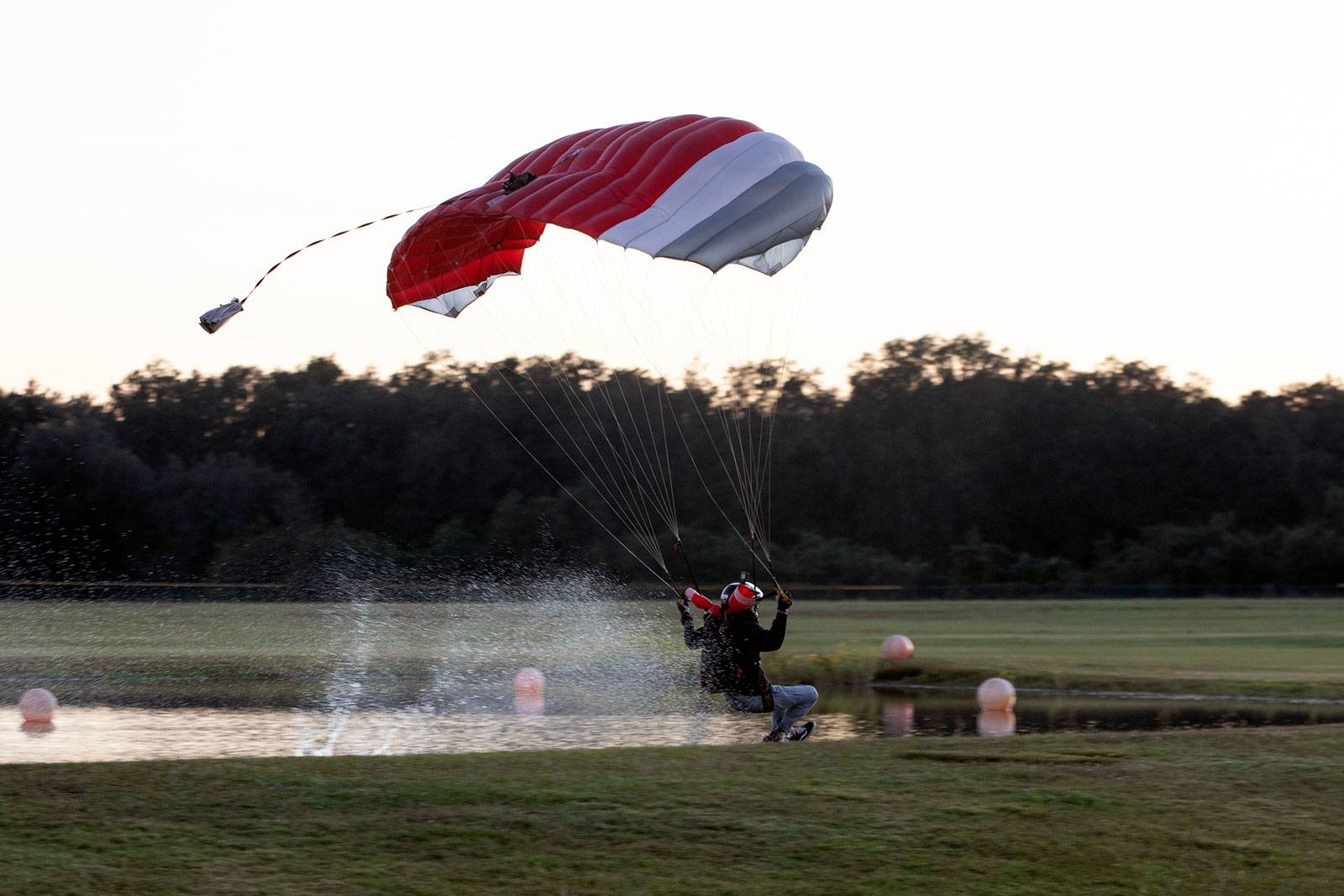 Experienced skydiver swooping in the pond at Skydive City Z-Hills