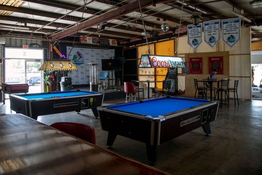 Blue pool tables inside of the Birdhouse Entertainment Center at Skydive City.