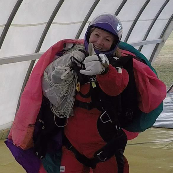 Audra Gonzalez giving a thumbs up while holding on to canopy.