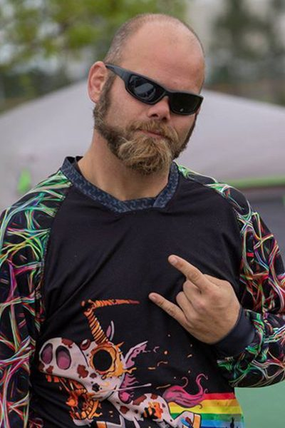 Justin Shafer giving rock on hand sign with black sunglasses