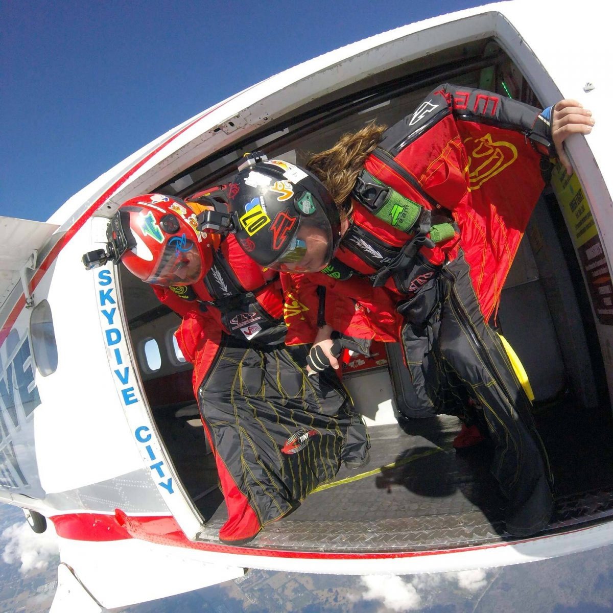 Wingsuiting jumpers getting ready to exit Skydive City airplanes.
