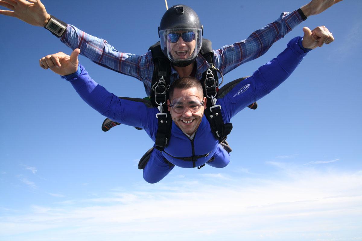 Tandem skydiver enjoying free fall at Skydive City