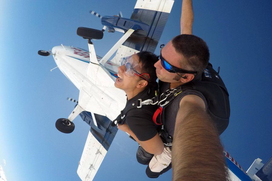 Male tandem skydiver in freefall after jumping from Skydive City aircraft.