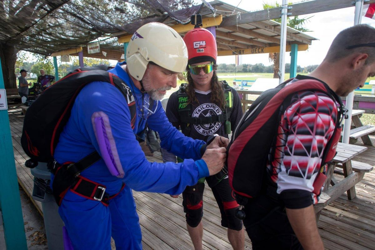 AFF Student in training at Skydive City's Florida's Best Skydiving School ™ learning about gear.