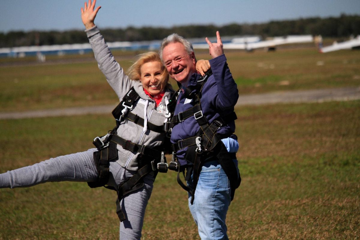 Couple celebrating after skydiving at Skydive City