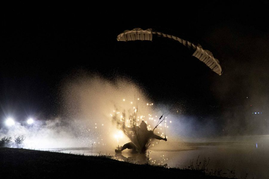 Experienced skydiver swooping in the water during night jumping.