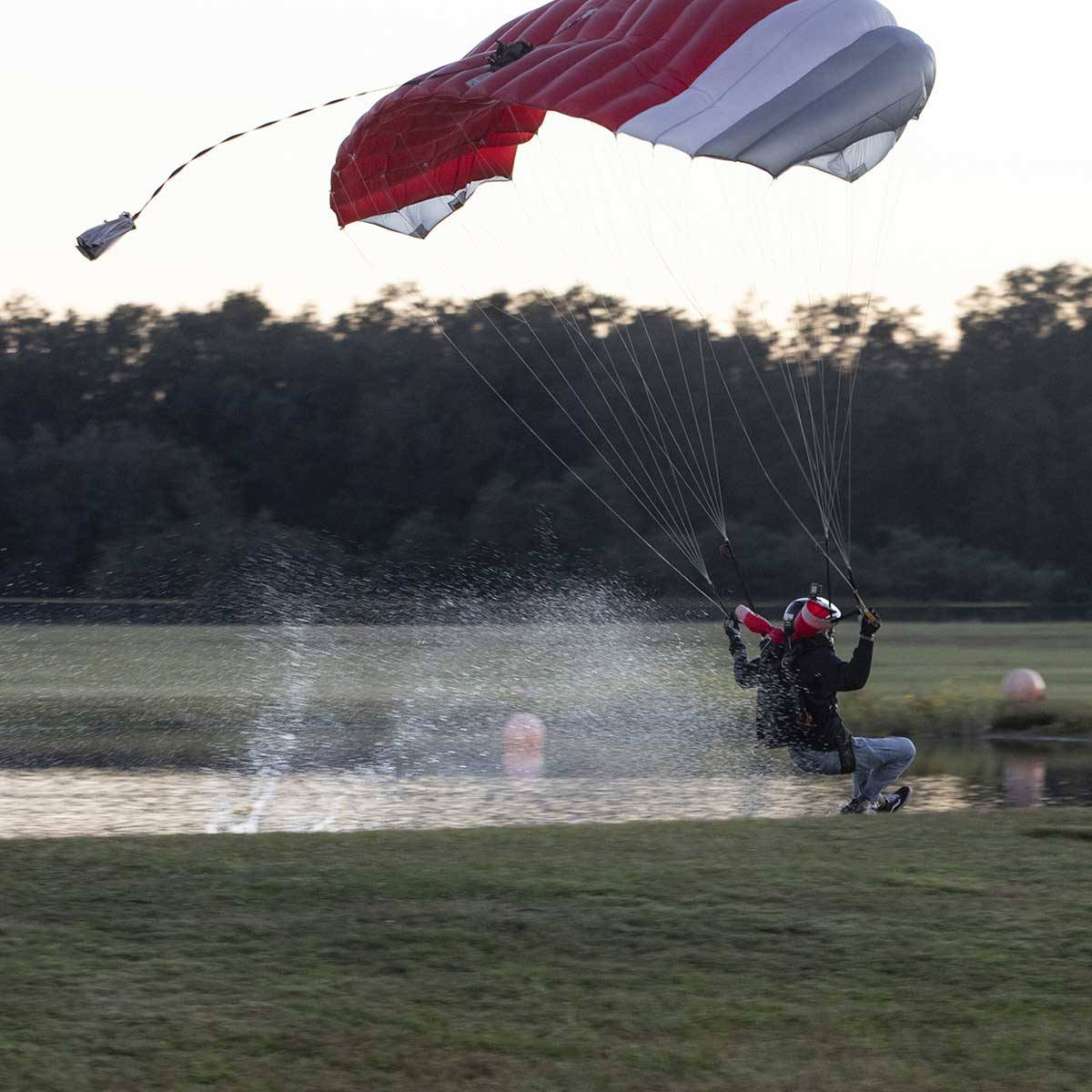 Experienced skydiver swooping in the water.