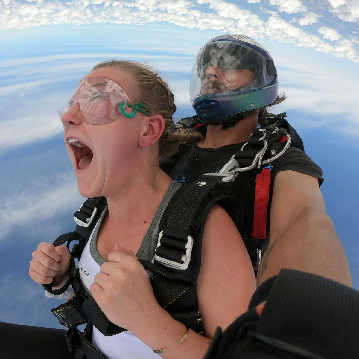 Female tandem student enjoying free fall while skydiving at Skydive City Z-Hills