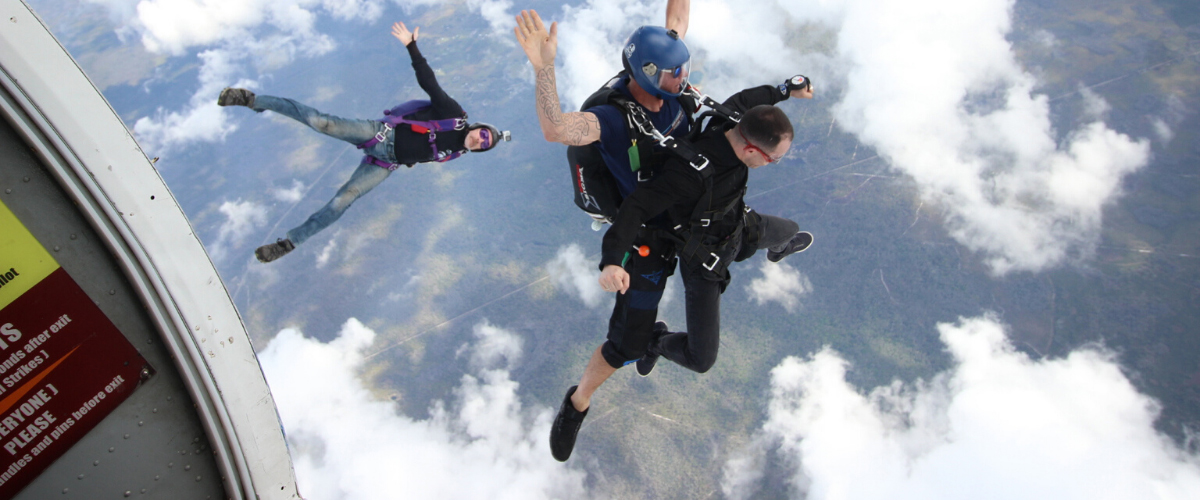 Male tandem skydiver in freefall after jumping from Skydive City aircraft