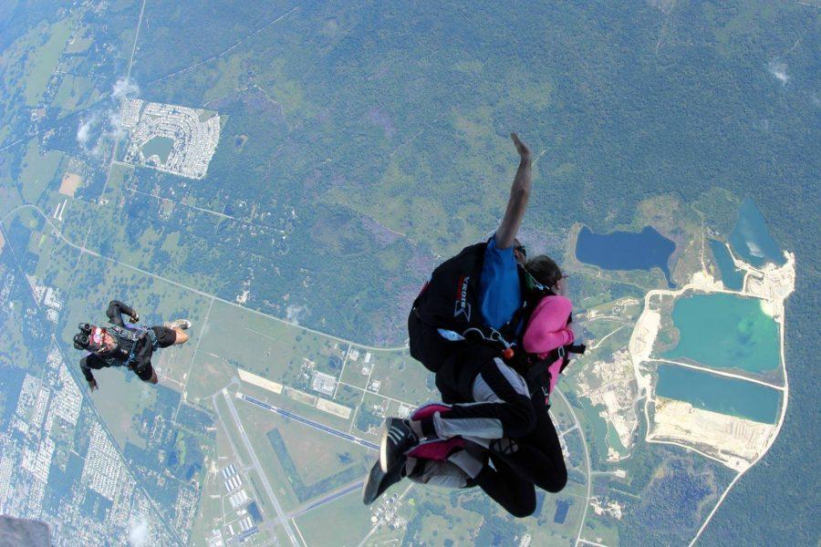 Female tandem jumper enjoying free fall